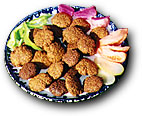 plate of falafel with fixins